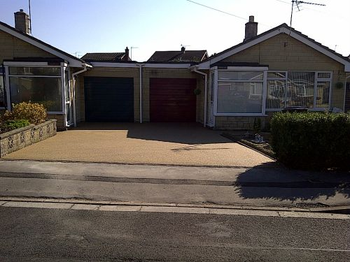 After, this new double driveway surfacing with resin bound paving by PJJ Sureset approved resin installer