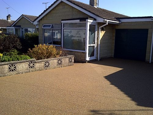 After this new double driveway surfacing with resin bound paving by PJJ Sureset approved resin installer
