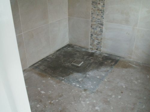 Resin bound alternative for indoor flooring in a wet room before photo